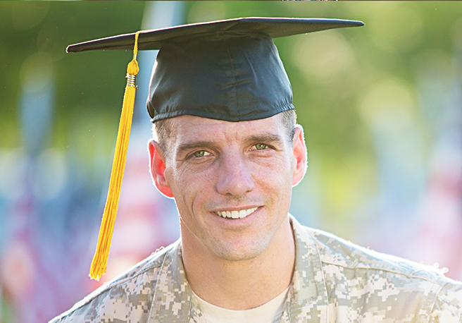 Stock image of a soldier wearing a graduation cap
