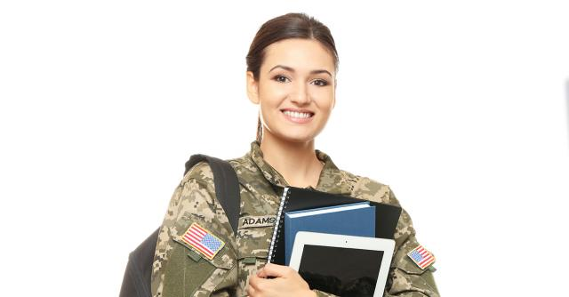 Female soldier carryiing textbooks