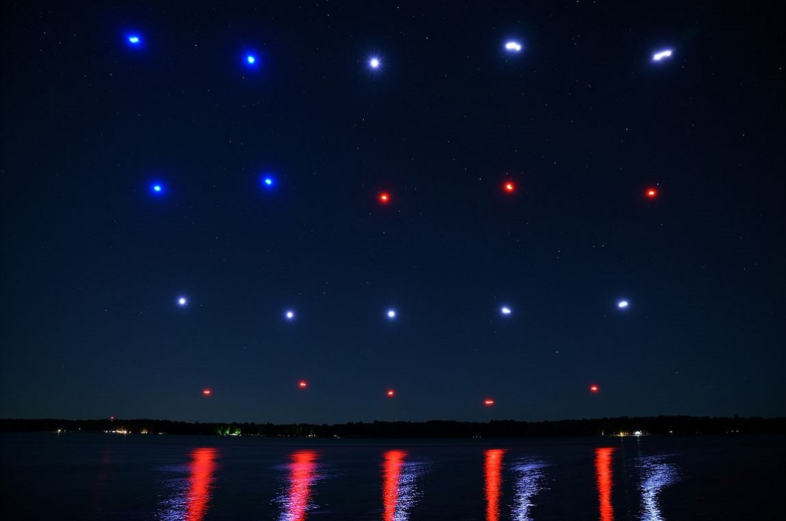firefly drones create a flag pattern in night sky