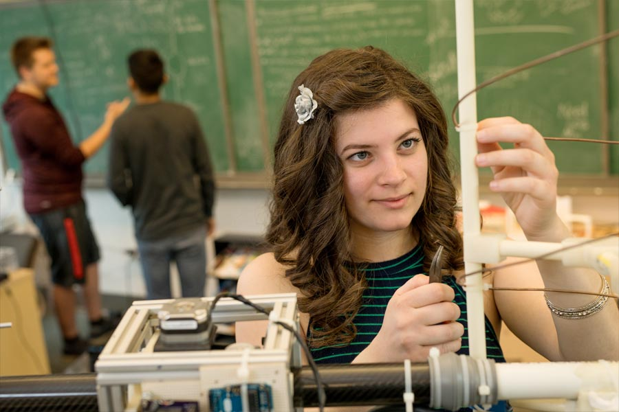 student working on antenna in lab