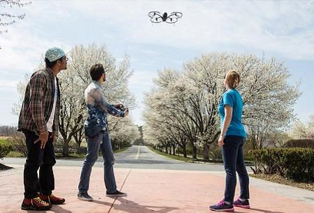 students flying a drone