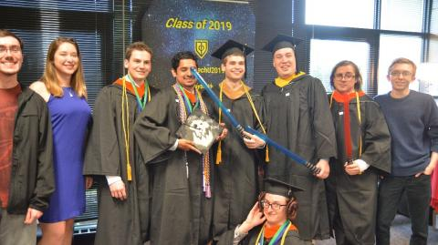 graduates pose in Star Wars photo booth