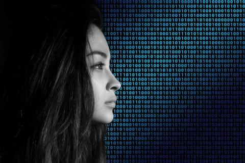 girl in front of binary background