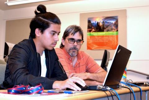 Dr. Sandy Antunes assists a young coder at a Capitol summer camp