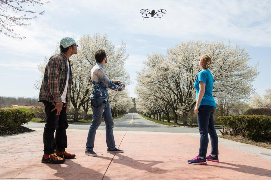 students flying drone